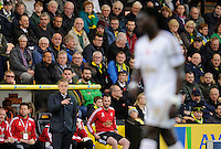 Swansea City Manager Garry Monk points as Bafetimbi Gomis of walks past during the Barclays Premier League match between Norwich City and Swansea City played at Carrow Road, Norwich on November 7th 2015