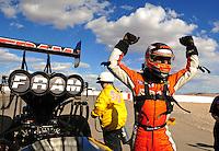 Apr. 1, 2012; Las Vegas, NV, USA: NHRA top fuel dragster driver Spencer Massey celebrates after winning the Summitracing.com Nationals at The Strip in Las Vegas. Mandatory Credit: Mark J. Rebilas-US PRESSWIRE