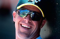 OAKLAND, CA - Mark Mulder of the Oakland Athletics smiles as he sits in the dugout during a game against the Kansas City Royals at the Oakland Coliseum in Oakland, California on July 6, 2002. Photo by Brad Mangin