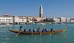 Venice-Italy - March 28, 2010 -- A team of eight rows a gondola on the Grand Canal / Canal Grande (not: Canale Grande), the St. Marc's Campanile in the back -- infrastructure, transport, water, people -- Photo: © HorstWagner.eu