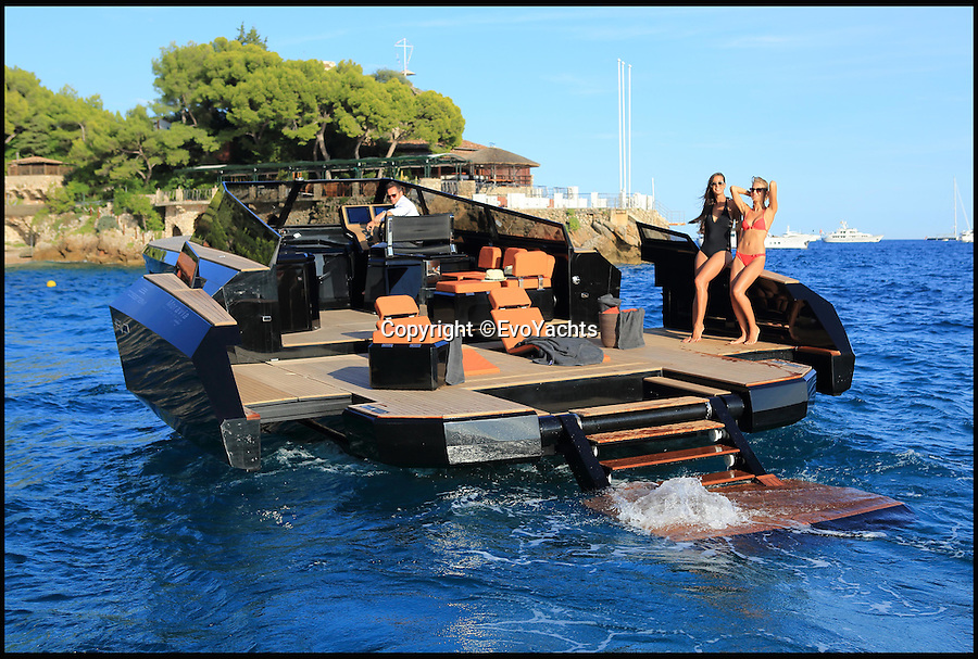 BNPS.co.uk (01202 558833)<br /> Pic: EvoYachts/BNPS<br /> <br /> This black luxury motorboat looks like it has been designed by Darth Vader as it has two expandable wings that slide out to create a 'party platform'.<br /> <br /> The sleek 42ft long craft looks like a normal speedboat until the touch of a digital control opens bulwarks at the rear to increase the cockpit space by 40 per cent.<br /> <br /> The quirky innovation appears to give the vessel angled wings resembling TIE Fighter craft in Star Wars.