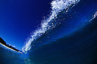 Wave with deep blue color and white shimmering crest