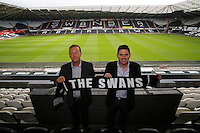 Pictured: Friday 22 July 2016<br />Swansea Chairman Huw Jenkins (L) and Jason Levien (R), one of the new US owners of Swansea City FC, at the Liberty Stadium, Swansea, Wales UK.