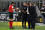 The referee Gianpaolo Calvarese speaks with Antonio Conte Head coach of Inter after showing him a yellow card during the Coppa Italia match at Giuseppe Meazza, Milan. Picture date: 12th February 2020. Picture credit should read: Jonathan Moscrop/Sportimage