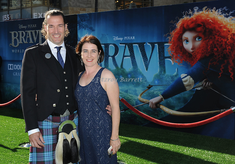"Mark Andrews and wife Patricia Andrews at the World Premiere of Disney Pixar's "" Brave "" at the grand opening of the Dolby Theatre Los Angeles, CA. June 18, 2012"