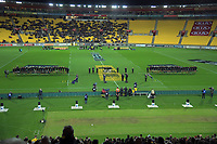 The teams line up to commemorate ANZAC Day before the Super Rugby match between the Hurricanes and Chiefs at Westpac Stadium in Wellington, New Zealand on Friday, 27 April 2019. Photo: Dave Lintott / lintottphoto.co.nz