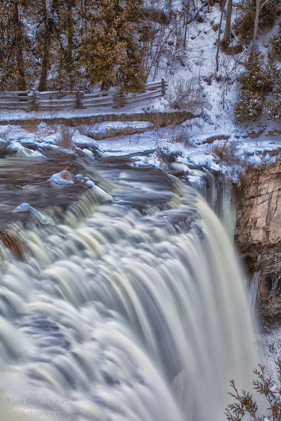 A view across the brink of Webster's Falls in the winter.
