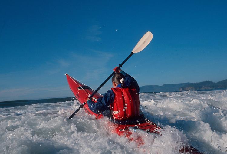Surf kayaking, woman sea kayaker, Pacific Ocean,, Shi Shi Beach, Olympic National Park, Olympic Peninsula, Washington State, Pacific Northwest, USA,.