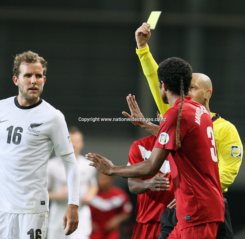New Caledonia's Emile Bearune is shown the yellow card after a bad challenge on Chris Wood in the 2014 FIFA World Cup Brazil Oceania qualifier, Forsyth Barr Stadium, Dunedin, New Zealand, Friday, March 22, 2013. Credit:NINZ/Dianne Manson