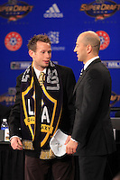 Ely Allen, who was selected in the second round by the Los Angeles Galaxy, talks with MLS deputy commissioner Ivan Gazidis during the MLS SuperDraft at the Baltimore Convention Center in Baltimore, MD, on January 18, 2008.