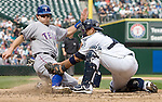 Texas Rangers' Ian Kinsler is tagged out after trying to score from third by Seattle Mariners catcher Guillermo Quiroz  in the sixth inning at SAFECO Field in Seattle on September 19, 2010. Kinsler was trying to score when Matt Treanor grounded into fielder's choice to third. The Mariners beat the Rangers 2-1.    UPI Photo/Jim Bryant Photo