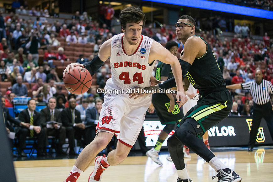 Baylor Bears center Isaiah Austin (21) defends against Wisconsin Badgers center Frank Kaminsky (44) during the fourth-round game in the NCAA college basketball tournament Thursday, March 27, 2014 in Anaheim, California. The Badgers won 69-52. (Photo by David Stluka)
