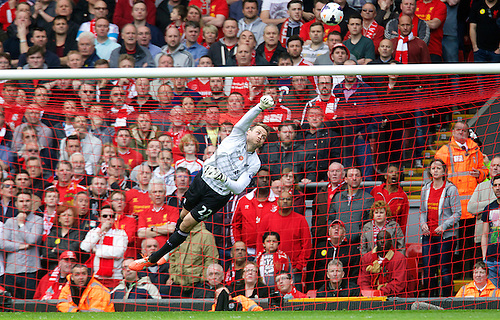 27.04.2014.  Liverpool, England. Liverpool's Simon Mignolet makes diving punch save  during the Barclays Premier League match between Liverpool and Chelsea at Anfield.