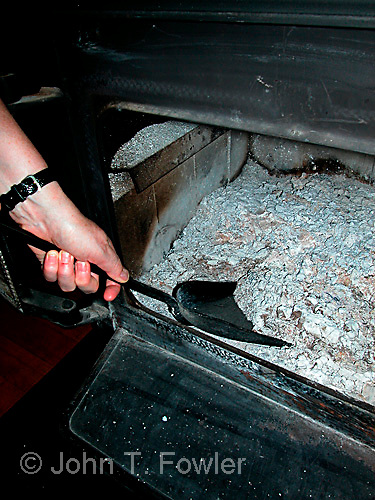 Emptying ashes from air-tight wood heater stove