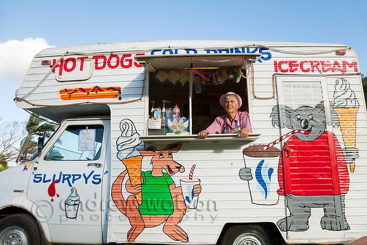 Woman in Australialiana themed ice cream van.  Cooktown, Queensland, Australia