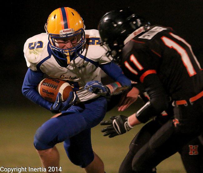 HOWARD, SD - NOVEMBER 8:  Samuel Jensen #9 from Alcester Hudson readies himself for a collision with Jordan Genzlinger #11 from Howard in the first half of their Class 9A Semifinal game Saturday night in Howard. (Photo by Dave Eggen/Inertia)