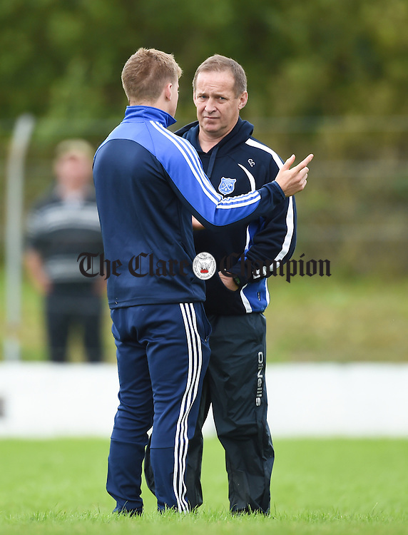 Podge Collins of Cratloe and his dad and Cratloe manager Colm Collins discuss tactics at half time during their game against Kilkee in Lissycasey. Photograph by John Kelly.