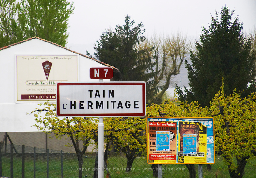 Road sign to Tain l'Hermitage and a bill board advertising the cave cooperative co-operative producer Cave de Tain l'Hermitage.  Tain l'Hermitage, Drome, Drôme, France, Europe