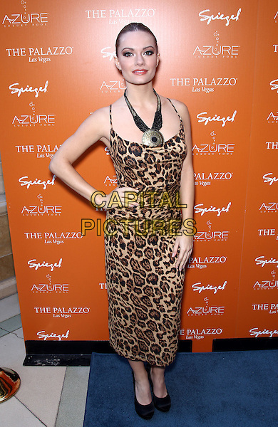CAITLIN O'CONNOR .Beverly Hills Housewives Kim and Kyle Richards host season premiere of Azure Luxury Pool at The Palazzo Resort Hotel and Casino, Las Vegas, Nevada, USA, 10th April 2011..Full length leopard animal print dress brown hand on hip necklace gold  sleeveless .CAP/ADM/MJT.© MJT/AdMedia/Capital Pictures.