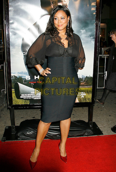 "LELA ROCHON.""Shooter"" Los Angeles Premiere held at Mann Village Theatre, Westwood, California, USA,.08 March 2007..full length black dress hand on hip.CAP/ADM/RE.©Russ Elliot/AdMedia/Capital Pictures."