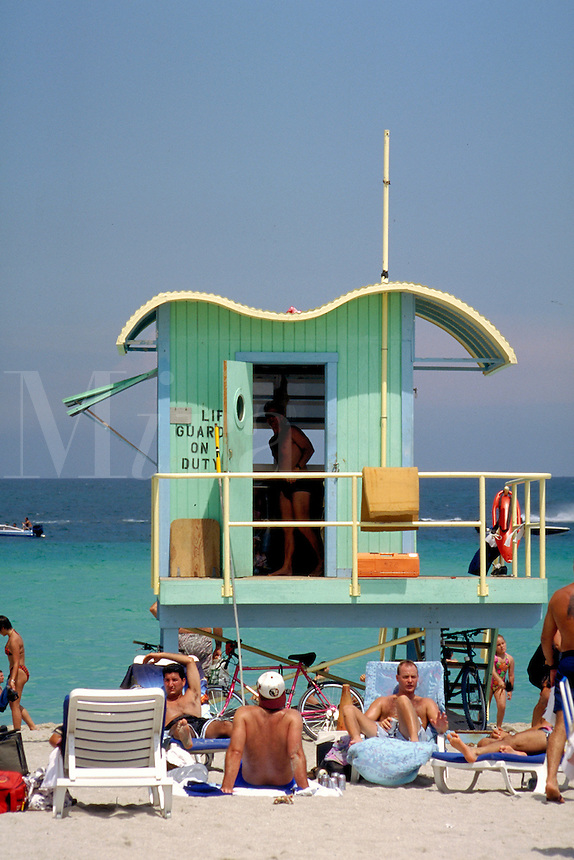 Aqua guardhouse draws sunbathers galore. Arch - William Lane, 1993. Miami Beach + 8th St. Beach FL USA.