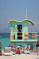 Aqua guardhouse draws sunbathers galore. Arch - William Lane, 1993. Miami Beach + 8th St. Beach FL USA.