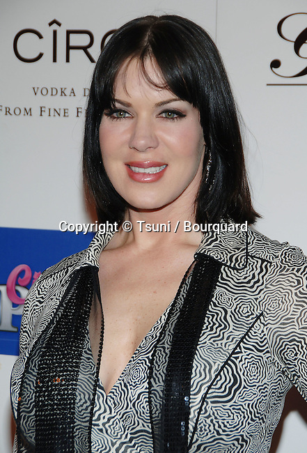 Joanie Marie Laurer (Chyna) arriving at the Guy's North Grand Opening in Los Angeles. February 19, 2006.