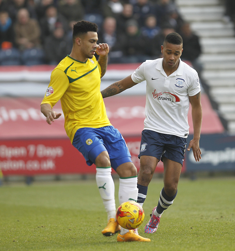 Coventry City's Jordan Willis in action with Preston North End's Chris Humphrey<br /> <br /> Photographer Mick Walker/CameraSport<br /> <br /> Football - The Football League Sky Bet League One - Preston North End v Coventry City - Saturday 7th February 2015 - Deepdale - Preston<br /> <br /> &copy; CameraSport - 43 Linden Ave. Countesthorpe. Leicester. England. LE8 5PG - Tel: +44 (0) 116 277 4147 - admin@camerasport.com - www.camerasport.com