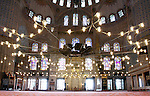 Muslims praying inside the Blue mosque, Istanbul, Turkey. The mosque is popularly known as the Blue mosque  because of the 20,000  tiles and embellishments which are mostly in blue and green colors from the walls and domes. The Blue mosque is the only mosque with 6 minarets in Turkey.