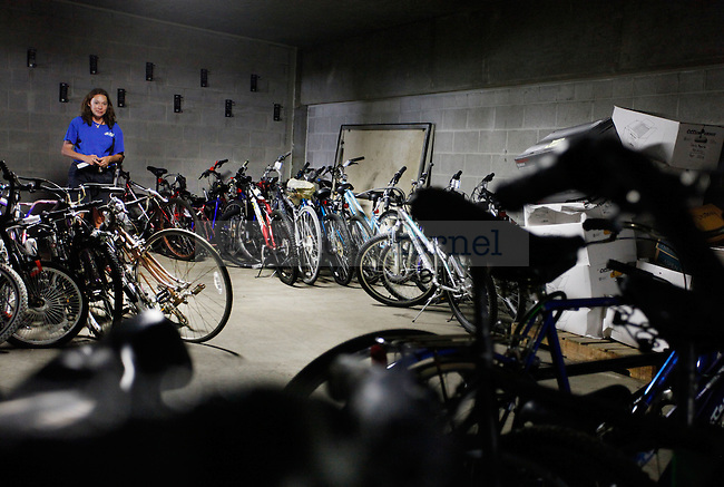 Bike Officer Beth Phillips looks at the collection of bikes in the bike impound at parking structure 5 on Monday, September 13, 2009. Photo by Zach Brake | Staff