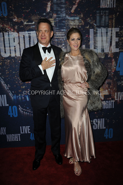 WWW.ACEPIXS.COM<br /> February 15, 2015 New York City<br /> <br /> Tom Hanks and Rita Wilson walking the red carpet at the SNL 40th Anniversary Special at 30 Rockefeller Plaza on February 15, 2015 in New York City.<br /> <br /> Please byline: Kristin Callahan/AcePictures<br /> <br /> ACEPIXS.COM<br /> <br /> Tel: (646) 769 0430<br /> e-mail: info@acepixs.com<br /> web: http://www.acepixs.com