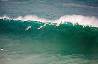 Surfers ride a wave at the 2016 Big Wave Eddie Aikau Contest, Waimea Bay, North Shore, O'ahu.
