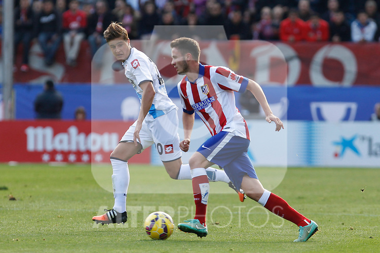 Atletico de Madrid´s Saul Niguez and Deportivo de la Coruña´s Wilk during 2014-15 La Liga match between Atletico de Madrid and Deportivo de la Coruña at Vicente Calderon stadium in Madrid, Spain. November 30, 2014. (ALTERPHOTOS/Victor Blanco)