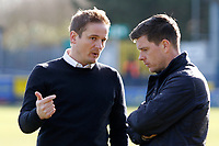 AFC Wimbledon manager, Neal Ardley speaks with Bristol Rovers manager, Darrell Clarke during the Sky Bet League 1 match between AFC Wimbledon and Bristol Rovers at the Cherry Red Records Stadium, Kingston, England on 17 February 2018. Photo by Carlton Myrie.