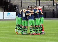 Pictured: Swansea players huddle before kick off Saturday 11 July 2015<br />