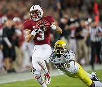 STANFORD, CA - November 7, 2013:  Stanford Cardinal wide receiver Michael Rector (3) catches a long pass during the Stanford Cardinal vs the Oregon Ducks at Stanford Stadium in Stanford, CA. Final score Stanford Cardinal 26, Oregon Ducks  20.