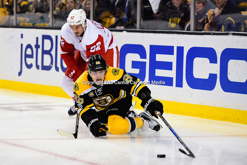 Tuesday, January 24, 2017: Boston Bruins right wing David Pastrnak (88) lunges for the puck during the National Hockey League game between the Detroit Red Wings and the Boston Bruins held at TD Garden, in Boston, Mass. Boston defeats Detroit 4-3 in overtime. Eric Canha/CSM