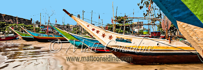 Fishermen take these colorful boats out at night and return early in the morning with their catches.<br /> (Photo by Matt Considine - Images of Asia Collection)