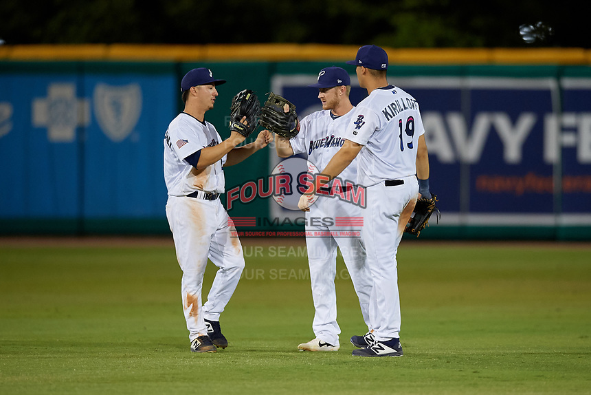 Pensacola Blue Wahoos left fielder Ernie De La Trinidad (25), center fielder Tanner English (4), and right fielder Alex Kirilloff (19) after closing out a Southern League game against the Biloxi Shuckers on May 3, 2019 at Admiral Fetterman Field in Pensacola, Florida.  Pensacola defeated Biloxi 10-8.  (Mike Janes/Four Seam Images)