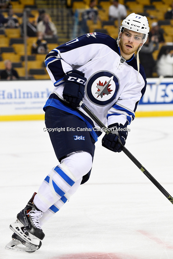 Thursday, October 8, 2015: Winnipeg Jets left wing Adam Lowry (17) warms up before the NHL game between the Winnipeg Jets and the Boston Bruins held at TD Garden, in Boston, Massachusetts. Winnipeg defeated Boston 6-2 in regulation time. Eric Canha/CSM