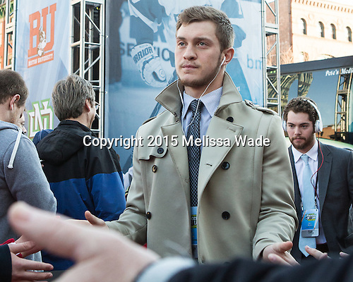 Matt Lane (BU - 21), Mike Moran (BU - 11) - The teams walked the red carpet through the Fan Fest outside TD Garden prior to the Frozen Four final on Saturday, April 11, 2015, in Boston, Massachusetts.