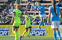 Seattle, WA - Sunday, April 17, 2016:  Sky Blue FC midfielder Shawna Gordon (2) heads the ball as Seattle Reign FC midfielder Jessica Fishlock (10) watches. Sky Blue FC defeated the Seattle Reign FC 2-1during a National Women's Soccer League (NWSL) match at Memorial Stadium.