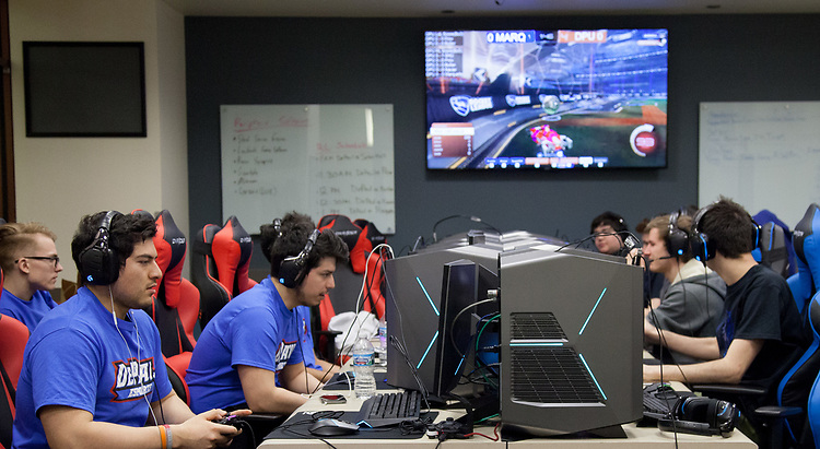The DePaul eSports team gathers for the BIG EAST eSports Invitational, Saturday, April 7, 2018, and Sunday, April 8, at DePaul's new gaming center on the Loop Campus. The teams played both Rocket League and League of Legends in the tournament this past weekend. Captain of the Rocket League team, Esteban Perez, was present, guiding his team to victories against Butler University, Xavier University and Marquette University. (Photo by Katie Donovan/DePaul University)