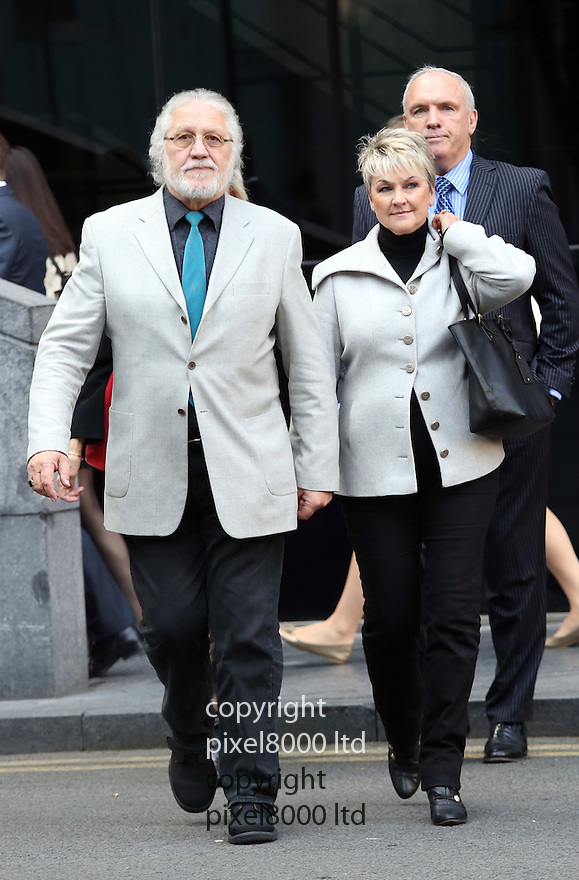 Pic shows: embattled DJ Dave Lee Travis a.k.a &quot;DLT the hairy cornflake snooker-on-the-radio wah-wah-oops&quot; star<br /> arrives at court today with wife Marianne where the jury were still deliberating on his sex charges<br /> <br /> <br /> <br /> <br /> Pic by Gavin Rodgers/Pixel 8000 Ltd
