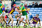 Michael O'Leary, Kerry, in action against Paudie Foley, Wexford, National Hurling League, Division 1B, Round 3, at Austin Stack Park, Tralee, on Sunday.