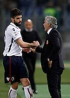 Calcio, Serie A: Roma vs Bologna. Roma, stadio Olimpico, 11 aprile 2016.<br /> Bologna's Luca Rossettini, left, is congratulated by coach Roberto Donadoni after scoring during the Italian Serie A football match between Roma and Bologna at Rome's Olympic stadium, 11 April 2016.<br /> UPDATE IMAGES PRESS/Isabella Bonotto
