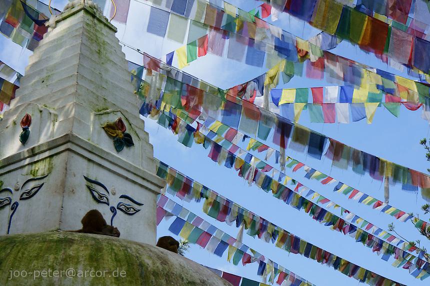 buddhist prayer flags with Mantras in Sanskrit written on it, fixed around Stupa (Manjushri shrine) below buddhist temple Swayambhu in Kathmandu, Nepal, September 2011