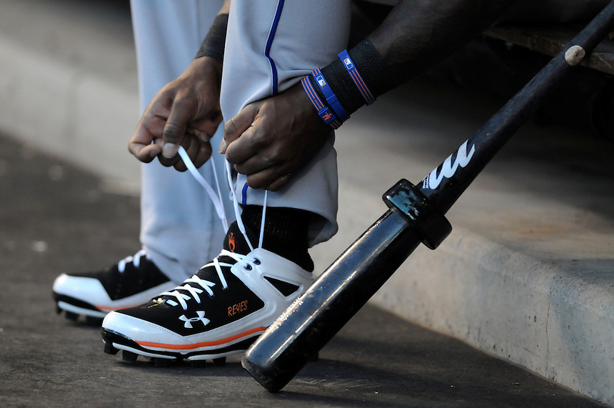 13 April 2010: New York Mets shortstop Jose Reyes ties his shoes in the dugout during a regular season Major League Baseball game between the Colorado Rockies and the New York Mets at Coors Field in Denver,  Colorado. The Rockies defeated the Mets 11-3.  *****For Editorial Use Only*****