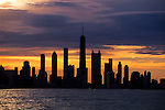 USA, ILLINOIS, CHICAGO, LAKE MICHIGAN, VIEW OF SKYLINE, SUNSET, DRAMATIC LIGHTING