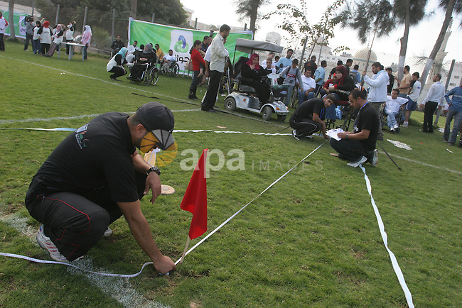Disabled Palestinians participate in an athletics championship for disabled  , in Gaza city on Nov. 29,2010. Photo by Mohammed Asad